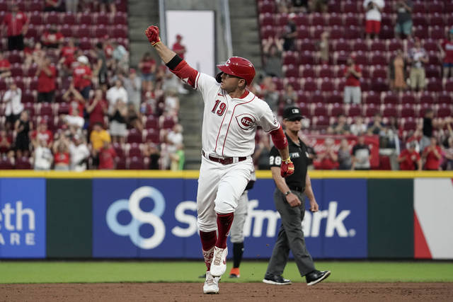 Cincinnati Reds' Joey Votto celebrates after hitting a three-run home run during the fourth inning of the team's baseball game against the Miami Marlins o Thursday, Aug. 19, 2021, in Cincinnati. (AP Photo/Jeff Dean)
