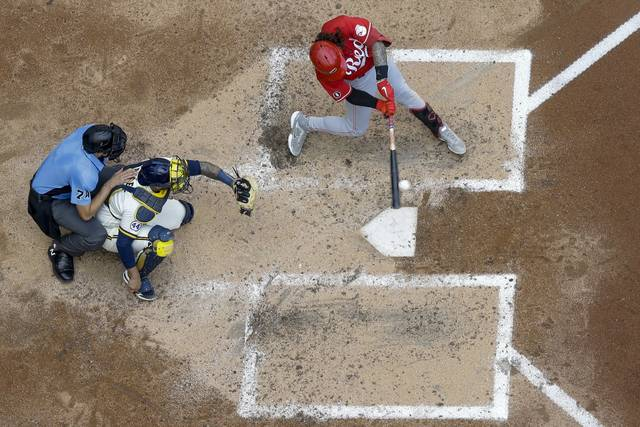 Cincinnati Reds' Jonathan India hits a three-run home run during the fifth inning of a baseball game against the Milwaukee Brewers Thursday, Aug. 26, 2021, in Milwaukee. (AP Photo/Morry Gash)