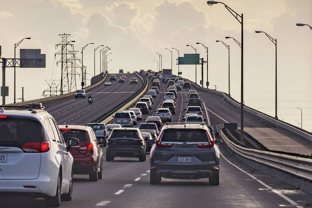 Vehicles head slowly east on the Interstate-10 twin spans leaving New Orleans while only a trickle of cars heads west back into the city before landfall of Hurricane Ida in New Orleans, Saturday, Aug. 28, 2021.    A combination of voluntary and mandatory evacuations have been called for cities and communities across the region including New Orleans, where the mayor ordered a mandatory evacuation for areas outside the city's levee system and a voluntary evacuation for residents inside the levee system.(AP Photo/Matthew Hinton)