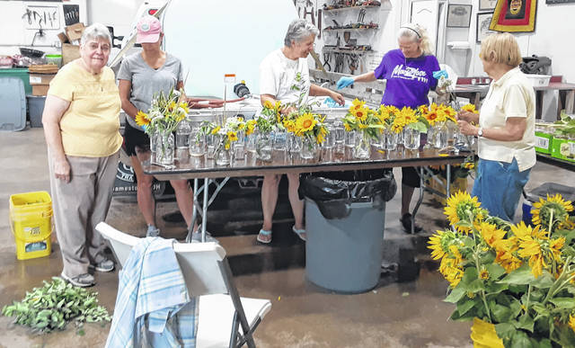 Volunteers prepare flower arrangements for Leadership Clinton's 12th Annual Dinner in the Fields fundraiser set for Saturday. From left are Kathleen Blake, Tanya Day, Diane Murphy, Denise Smith and Caroline Matthews.