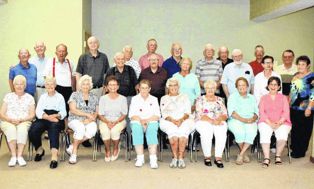 The Simon Kenton Class of 1956 and 1957, along with guests, met for the reunions on Saturday, August 14. From left are: front row, Mary Jane Bean Bentley, Evelyn Ellis Pickering, Mary Ann McFadden Moore, Junia Mesecher Bond, Judy Bernard Campbell, Mary Alice Hartman Thatcher, Nancy Jandes Knapp, Jane Babb Warehime, and Shirley McFadden Webb; second row, Marvin Bond, Bob Centers, James Georges, Phil Centers, Sam Moore, Richard Leslie, Sondra Nordyke, Joe Pinkerton, and Mary Beth Campbell. Back row, from left, Herschel Knapp, Earl Murphy, Charles Pitzer, Dorsey Wilson, Robert Webb, Don Henry, Donald Lindsey, and Jo Anne Hartman Lindsey.
