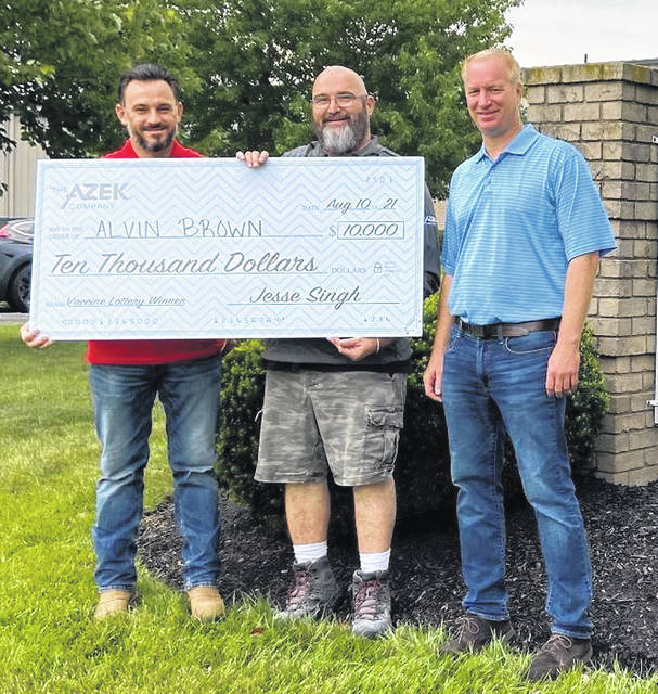 AZEK, which has a large manufacturing plant in Wilmington, recently held its second drawing for employees who have completed COVID-19 vaccinations. The most recent winner of $10,000 was Alvin Brown, who works at another site. From left are Nic Mazzotta, Plant Manager; Alvin Brown; and Chad Oney, General Manager.
