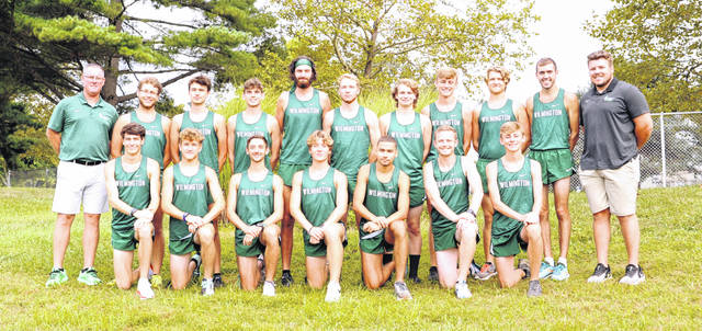The Wilmington College men's cross country team, from left to right, front row, Simon Heys, Cohen Frost, George Rickett, Noah Tobin, Tyler Parks, Austin Wampler, Brant Haines; back row, Head Coach Ron Combs, Evan Brandon, Patrick Bay, Eric Reynolds, Josh Cyrus, Aidan Henson, Justin Weckler, Blake Haines, Gage Clemens, Hunter Morgan, Assistant Coach Tristen Durr.