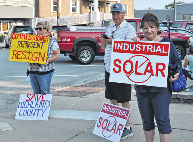 Opponents of a solar farm in Highland County protest its establishment Wednesday at the corner of West Main Street and Governor Foraker Place in Hillsboro.
