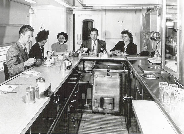 """This photo is of the interior of a diner, but no other information is available. Could it possibly be the interior of the """"Little Giant"""". Can you tell us more? Share it at info@wnewsj.com. The photo is courtesy of the Clinton County Historical Society. Like this image? Reproduction copies of this photo are available by calling the History Center. For more info, visit www.clintoncountyhistory.org; follow them on Facebook @ClintonCountyHistory; or call 937-382-4684."""