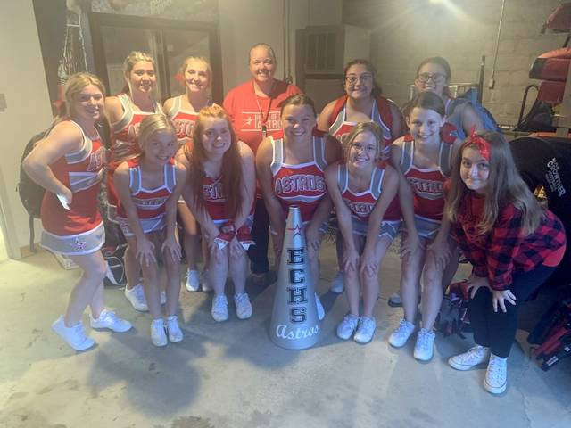 With play halted by lightning, East Clinton cheerleaders went to cover at the concession stand at ECHS. (Photo by Melony Arnold)
