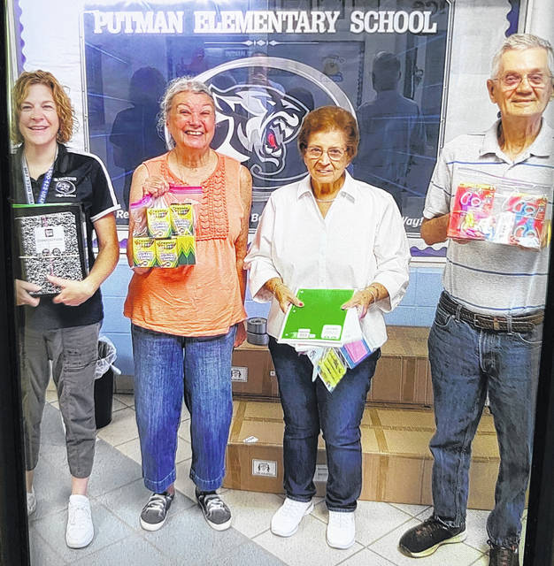 This marks the 20th year the Dems for Kids program of the Clinton County Democratic Party has donated school supplies to each county elementary school. Donated supplies include book bags, paper, pencils, crayons, scissors and other items needed by young students. From left are Blanchester's Putman Elementary school secretary Caryn McCarty; Connie Hardie, Dems for Kids; Linda Larrick, Putman secretary; and Don Spurling, Dems for Kids.