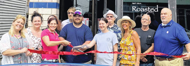 The ribbon-is cut at Roasted in Blanchester.
