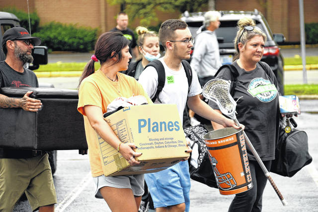 New student Brock Fugate, with help from his family, Jimmy, Kaylee and Beth, moves into Pickett Hall Thursday morning. They are from Beavercreek.