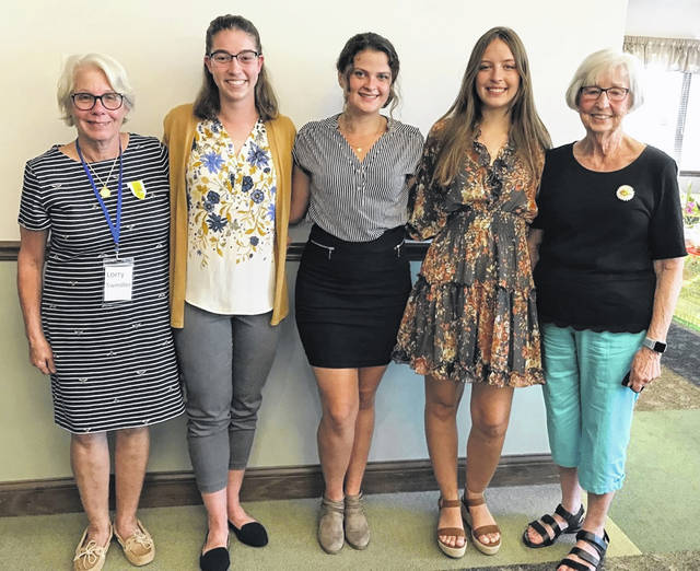 From left are: Lorry Swindler, president; recipients Jordan Snarr, Jenna Norman, and Maddie Webber; and Suzanne Madison, scholarship chairman.