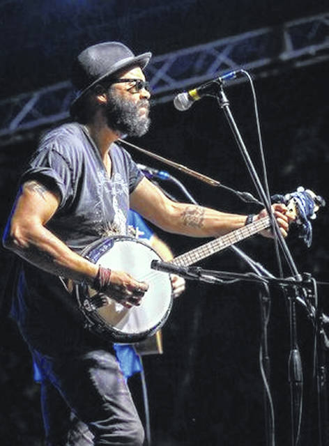 George Byrd plays his banjo at the Laurel Cove Festival in Kentucky in June.