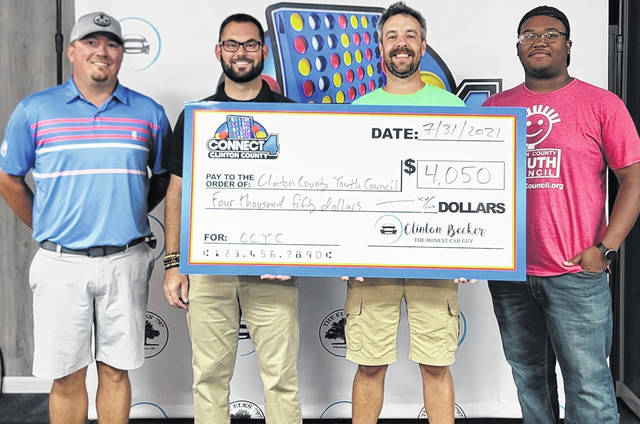 """The July """"Connect 4 Clinton County"""" game night raised $4,050 for the non-profit organization Clinton County Youth Council (CCYC), led by Eric Guindon, second from right. The CCYC is a free after-school youth center located on West Sugartree Street in Wilmington."""