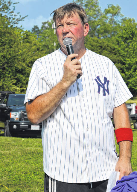 Dave Carroll, the father of Tiffany Jackson who died of cancer, speaks prior to the Old-Timers Game at the Clarksville ball diamond Saturday. A weekend Tiffany Jackson Memorial Tournament for softball teams was a success. More than once during his talk Carroll said he wouldn't trade his softball experiences for the world.