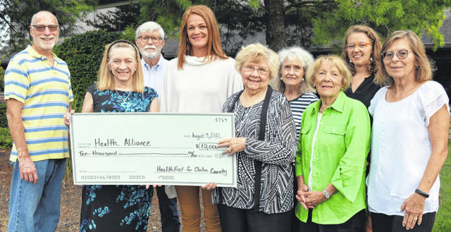 Health Alliance of Clinton County received $10,000 toward its scholarship program for healthcare workers in Clinton County. HealthFirst for Clinton County provided the grant. From left in the front row are Patricia Richardson, Staci Close, Frances Sharp, Carolyn Matthews and Patti Settlemyre all of whom are representing Health Alliance of Clinton County; and in the back are Jeff Drapalik, Bill McCracken, Chris Henry and Megan Fair, all with HealthFirst for Clinton County.