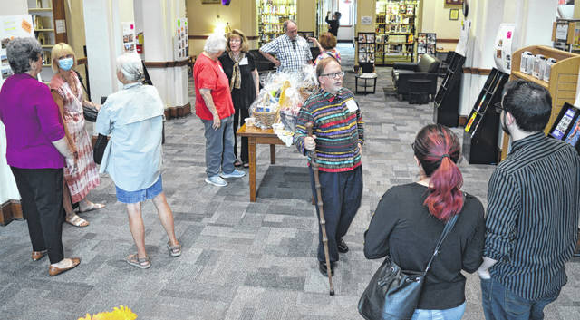 Refreshments, gift baskets, and posters about the library building's history were part of the open house.