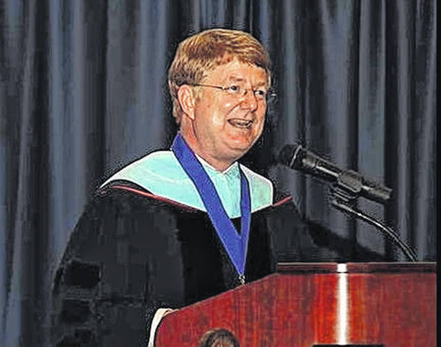 SSCC President Dr. Kevin Boys speaks at a graduation ceremony.