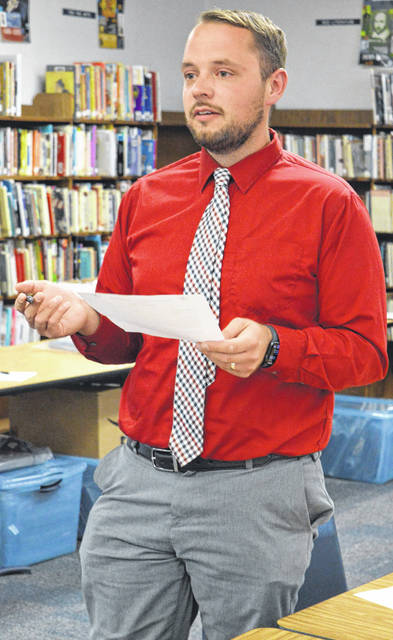 New East Clinton Middle School Principal Matt Melnek delivers his first report to the school board.