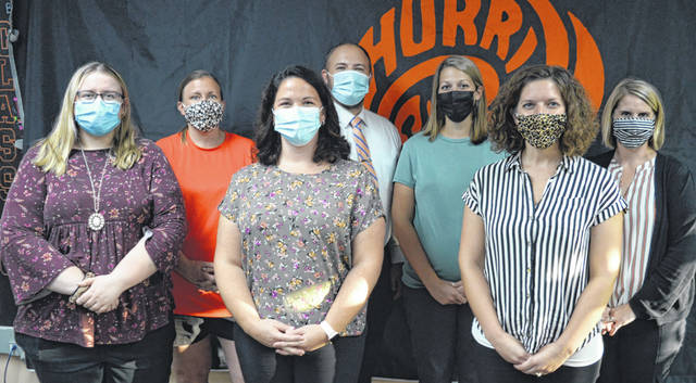 New Wilmington City Schools staff were introduced at the school board meeting. Those present were, front row from left, Cheyenne Wolfenbarger, Amber Dorsch and Crystal Pergram; and the back row, Tammy Martin, Ryan Hutcherson, Tyne Davis and Amber Corcoran.