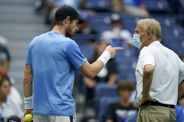 Andy Murray, of Great Britain, complains to an official between sets against Stefanos Tsitsipas, of Greece, during the first round of the US Open tennis championships, Monday, Aug. 30, 2021, in New York. (AP Photo/Seth Wenig)
