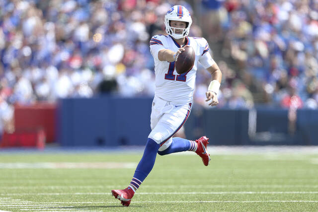 Buffalo Bills quarterback Josh Allen scrambles for a gain during the first half of a preseason NFL football game against the Green Bay Packers, Saturday, Aug. 28, 2021, in Orchard Park, N.Y. (AP Photo/Joshua Bessex)