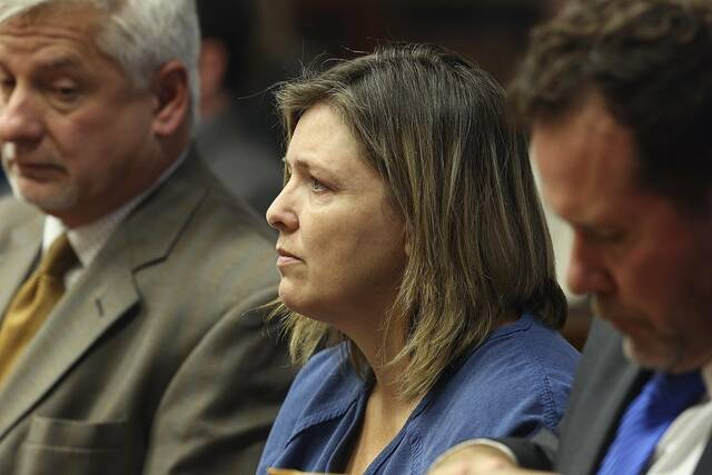 FILE - Angela Wagner sits next to her lawyers in the Pike County Common Pleas Court for her arraignment in Waverly, Ohio on Thursday, Nov. 29, 2018. Wagner, her husband and sons are charged in the 2016 Rhoden family shootings. (Brooke LaValley/The Columbus Dispatch via AP, File)