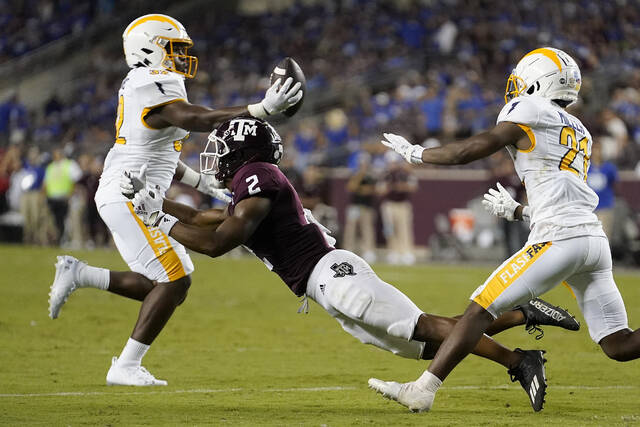 Kent State linebacker Khalib Johns, left, intercepts a pass meant for Texas A&M wide receiver Chase Lane (2) during the second half of an NCAA college football game on Saturday, Sept. 4, 2021, in College Station, Texas. (AP Photo/Sam Craft)
