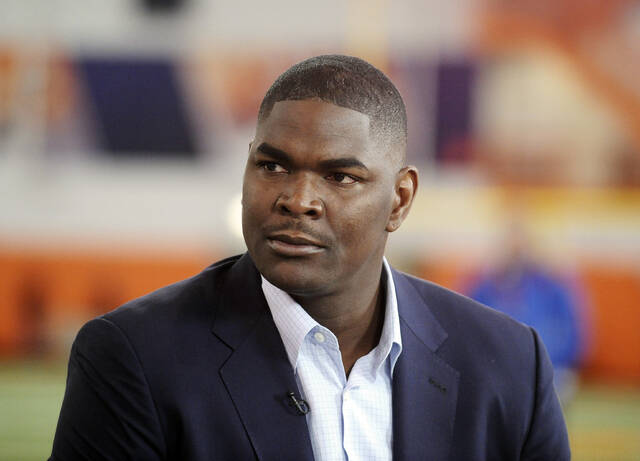"""FILE - In this March 6, 2014, file photo, former NFL and Southern California receiver Keyshawn Johnson appears during the Clemson NCAA college football pro day in Clemson, S.C. In this era of racial reckoning, it is not only appropriate but significant that the stories of NFL trailblazers be told. Johnson, the 1997 top overall draft pick by the New York Jets and now host of ESPN's morning program, has done so. Collaborating with Bob Glauber, the Newsday columnist and 2021 recipient of the Bill Nunn Jr. Award by the Pro Football Writers of America for outstanding long-time reporting, Johnson has authored """"Forgotten First."""" (AP Photo/Rainier Ehrhardt, File)"""