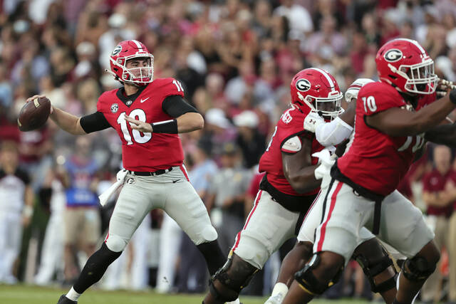 Georgia quarterback JT Daniels (18) throws a pass against South Carolina during the first half of an NCAA college football game Saturday, Sept. 18, 2021, in Athens, Ga. (AP Photo/Butch Dill)
