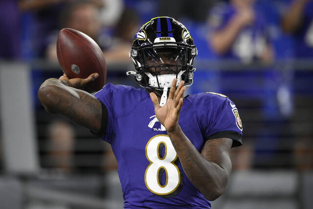 Baltimore Ravens quarterback Lamar Jackson warms up before an NFL football game against the Kansas City Chiefs, Sunday, Sept. 19, 2021, in Baltimore. (AP Photo/Nick Wass)