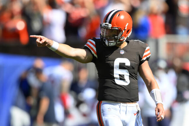 Cleveland Browns quarterback Baker Mayfield celebrates a 33-yard touchdown by running back Demetric Felton during the second half of an NFL football game against the Houston Texans, Sunday, Sept. 19, 2021, in Cleveland. (AP Photo/David Richard)