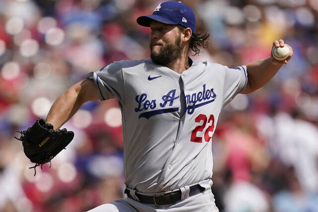 Los Angeles Dodgers starting pitcher Clayton Kershaw (22) delivers during the first inning of a baseball game against the Cincinnati Reds in Cincinnati, Sunday, Sept 19, 2021. (AP Photo/Bryan Woolston)