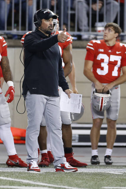 Ohio State head coach Ryan Day signals to his team during the second half of an NCAA college football game against Akron, Saturday, Sept. 25, 2021, in Columbus, Ohio. (AP Photo/Jay LaPrete)