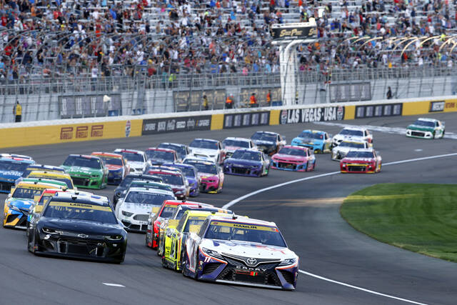 Drivers restart after a caution during a NASCAR Cup Series auto race at Las Vegas Motor Speedway. Sunday, Sept. 26, 2021, in Las Vegas. (AP Photo/Steve Marcus)