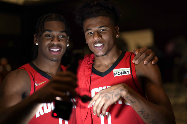 Houston Rockets' Jalen Green, right, and Josh Christopher film themselves during an NBA basketball media day Monday, Sept. 27, 2021, in Houston. (AP Photo/David J. Phillip)