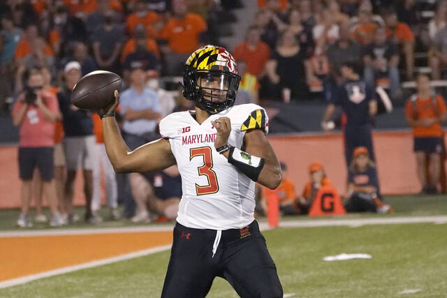Maryland quarterback Taulia Tagovailoa throws a pass during the first half of the team's NCAA college football game against Illinois on Friday, Sept. 17, 2021, in Champaign, Ill. (AP Photo/Charles Rex Arbogast)