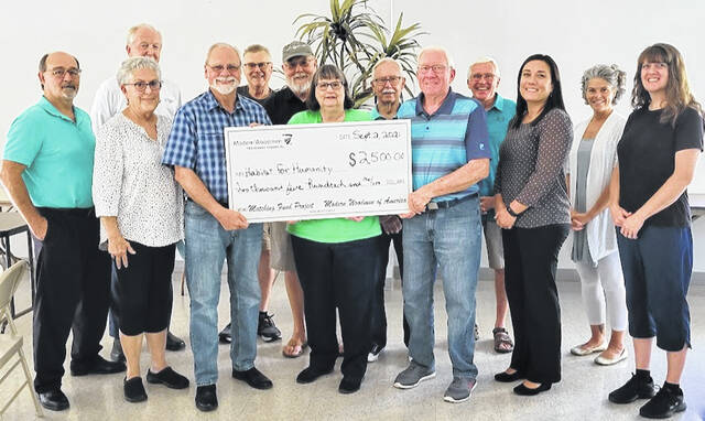 From left are: back row, Bob Schaad, Tom McChain, Mike Miller, Dan Kennelly, Tom Matrka, Elizabeth Biggane; and, front row, Steve Riehle, Kathy Collins, Dan Mayo, MWA Rep, Mary Camp (center, holding check), Wendell Compton, Danielle Thiel, and Beth Davis.