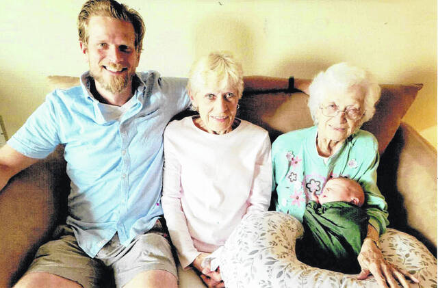 From left, father Zachary Cook, grandmother Renita Cook, and great-grandmother Leanna holds little Gavin Cook.