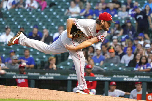 Cincinnati Reds starting pitcher Wade Miley watches a throw during the first inning of the team's baseball game against the Chicago Cubs on Tuesday, Sept. 7, 2021, in Chicago. (AP Photo/Charles Rex Arbogast)