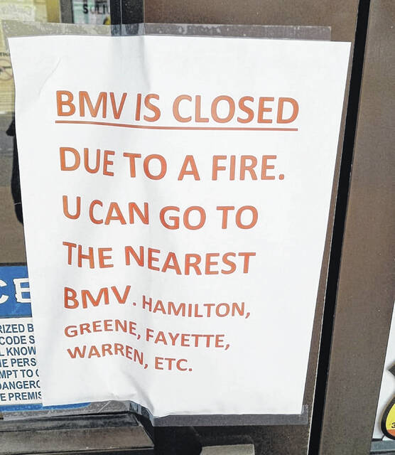 A sign posted outside the BMV.