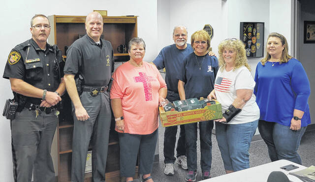 At the Clinton County Sheriff's Office, from left are Deputy Addison Stonewall, Sgt. Robert Gates, Vickie Gregory, MWA Financial Rep Dan Mayo, MWA Chapter Coordinator Bev Mayo, Bonnie Kelly, and Communications Officer Amy Ritt.