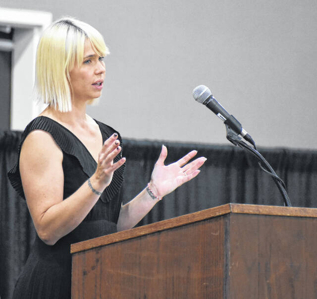 Dessie Rogers, Executive Director of the Wilmington-Clinton County Chamber of Commerce, welcomes those to the chamber's annual meeting. Locals were honored with the Clinton County Community Champions Awards at the Roberts Convention Centre.
