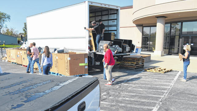 East Clinton FFA and Clinton County Foundation volunteers worked under the hot sun to collect and sort the dropped off electronics for recycling.