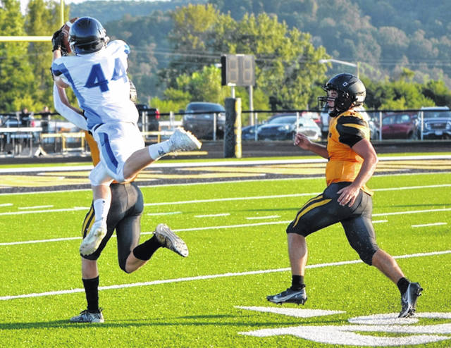 Blanchester's Dustin Trace goes up for an acrobatic catch during the season opener against Paint Valley.