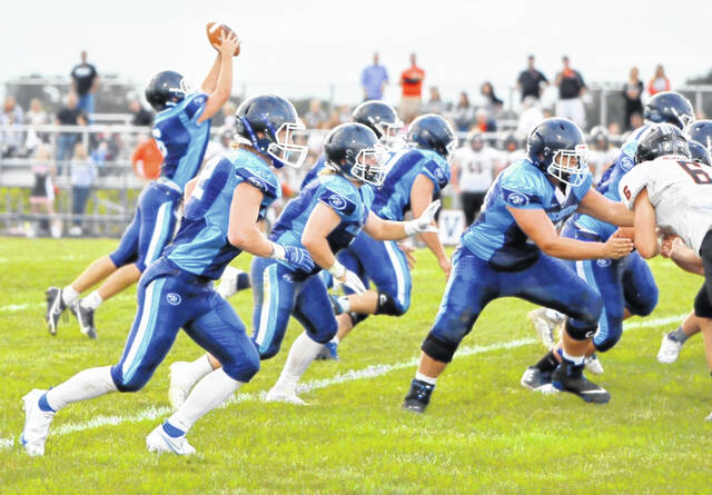 The Blanchester offensive line fires off the ball during last week's game against Waynesville.