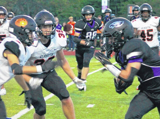 Wilmington's Jeff Valentine (39) moves in on a CHCA ball carrier during last week's game.
