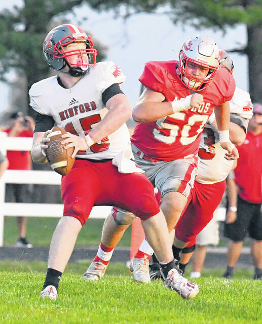 East Clinton's Mitchell Bean (50) bears down on a Minford ball carrier during last week's game at ECHS.