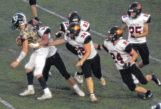 Wilmington's Blaize Johnson (34), Shane Griffith (23), Owen Bloom (32), Thane McCoy (24) and Caydn Denniston (25) swarm to an Edgewood ball carrier during last week's game.