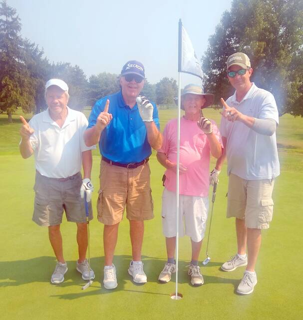 Jim Burton recorded his first hole-in-one Monday at the Elks 797 Golf Club. Burton's ace came on the 159-yard par 3 No. 9 hole. He used a 6-iron. Burton's playing partners on the day were, from left to right, Don Clagett, Burton, Mark Baughman and John Burton, Jim's son.
