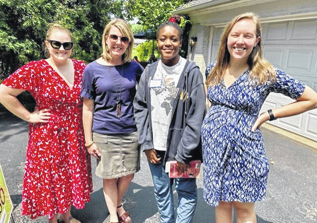 During a visit to Clinton County which included making purchases at the Farmers Market, from left are Rachel Rossi, Congressional candidate Democrat Allison Russo, Jericca Taste, and City of Wilmington Councilmember Kelsey Swindler.