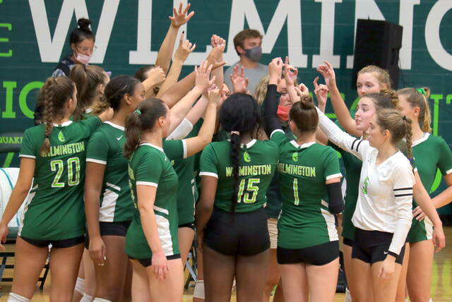 The Wilmington College volleyball team huddles around head coach Sophie Windover Wednesday in the first match of the season. WC defeated Northwestern Ohio and lost to Midway.